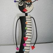Figurine demi teinte (noir et beige)